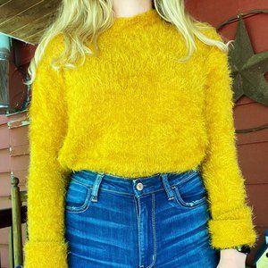 Orange eyelash sweater!